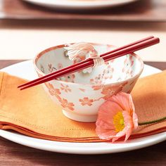 beautiful place setting for a Chinese New Year meal...love those tied chopsticks