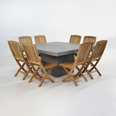 """This beautiful 63"""" square concrete table from Teak Warehouse gives any space a modern look. This set includes 8 chairs that fold up for easy storage."""