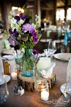 The final centerpiece was a wood slice with a vintage blue ball jar of flowers.