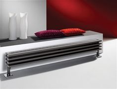 The Vasco Zana Plinth is a compact low level radiator which fuses horizontal rectangular tubes with a perforated central grille to provide comfortable levels of heat. Stocked in metallic anthracite complete with Chrome foot plate rosette, colour options available and are made to order. Prices start from £439.68