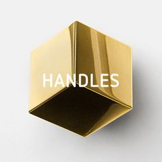 Handles by Superfront.  Amazing Swedish company that makes handles, pulls, knobs, legs, doors, etc to fit IKEA cabinetry, beds & wardrobes.  Brilliant!