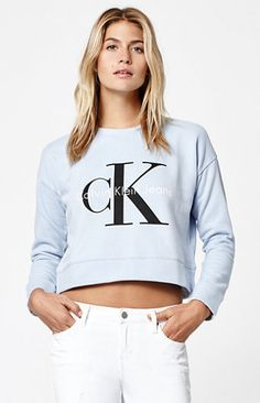 "Made from soft fleece, this Calvin Klein crew neck sweatshirt has a timelessly cool look. It's sporty and feminine with a cropped silhouette, light blue wash and classic wordmark on front.   	Crew neckline 	Tonal wordmark on front 	Cropped cut 	Model is wearing a small 	Model's measurements: Height: 5'10"" Bust: 34"" Waist: 24"" Hips: 34"" 	Cotton, poly blend 	Machine washable"