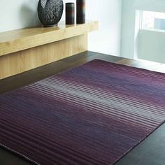 Horizontal Stripes seamlessly blended with dusky colour tones. Modern & Stylish Rug #modernrugs #stripedrugs #woolrugs #largerugs #purplerugs