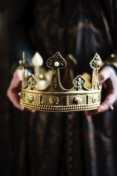 A crown that belonged to Hamlet's father but sat upon his uncle's head. After Claudius had poured poisen into his own brothers ear.