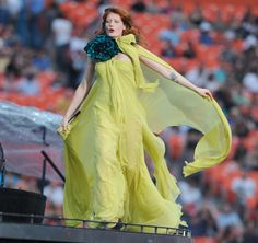 Florence Welch performs in a yellow Gucci gown
