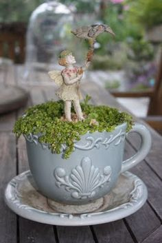 Would be cute as just moss filled tea cups in the garden....maybe on steaks at different levels throughout or as markers in vegetable garden