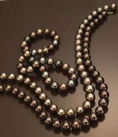 18k gold and multicolor chocolate pearl strand and pearl strands