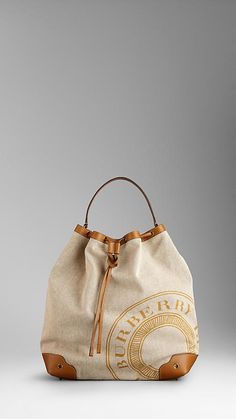 Burberry - Heritage Logo Canvas Hobo. I'm not really one who likes or needs to show the label, but this is adorable.