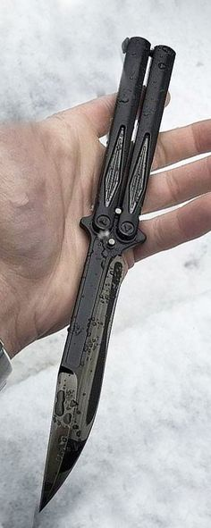 Microtech Tachyon III Balisong Butterfly Knife. This Tachyon III model has a black finished, Bohler M390 steel clip point blade and durable type III black anodized handles with bead blasted hardware. Includes adjustment tool. #balisong #butterflyknife
