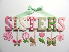 Baby Name Sign in Polka Dots (4 Letters) - Custom Hand Painted Wood Letters on a Personalized Wall Hanging for Nursery. $59.00, via Etsy.