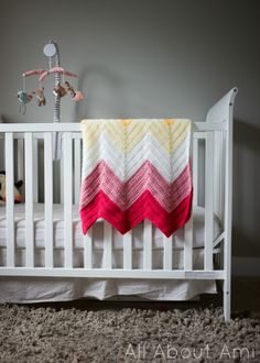 """Free crochet pattern for """"Bold and Bright Chevron Blanket""""!  Choose your own colours to make this striking baby blanket!"""