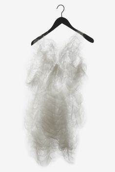 Ying Gao. So delicate, I'd be too scared to wear it!