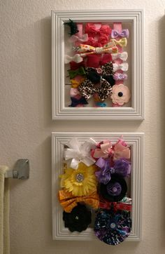 Use empty frames, staple ribbon onto the backside of the frame and clip on baby girl bows. I hung this in her bathroom..sorry for the lighting her bathroom light isn't the greatest for pictures:-)