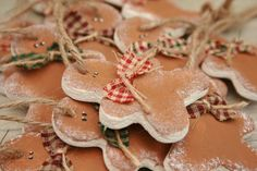 Hand cut, hand painted and finished small primitive, rustic hanging gingerbread men decorated a small bows . Ideal for Christmas tree decorations,