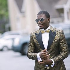 Great jacket! Great photo! Great Groom!! Wale is wearing 'The Manhattan Gold Brocade Tuxedo Jacket' from the 'Cabaret Collection for Men' by Ellis Esq. http://www.cabaretvintage.com/mens/the-manhattan-black-gold-brocade-dinner-jacket/: