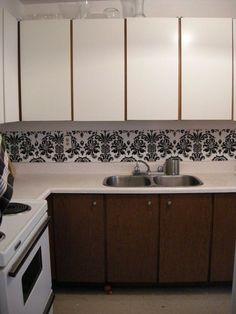"""Dollar Store Place mats lined up and """"pinned"""" or double sided taped along wall; lining up the design, as best possible White Contact paper on the cabinets"""