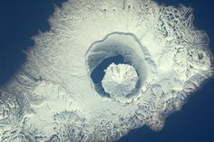 Taken from Space by European Space Agency Astronaut Paolo Nespoli  - Volcano, Onekotan Island, Russia. May 23, 2011