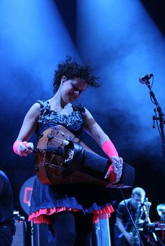 Regine Chassagne of Arcade Fire playing the hurdy gurdy. Photo by Alan Bee