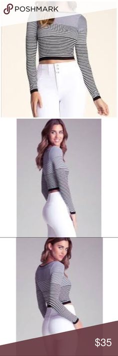 Bebe Stripe Long Sleeve Crop Top Long sleeve stripped crop top is fitted and features a unique black trim along the scoop neck collar, and white trim at sleeve and bodice hem. Wore this once on vacation, like new in excellent condition! Comes from a smoke and pet free home.   Bebe size: M/L fits like a small Medium   92% Nylon, 8% Spandex bebe Tops Crop Tops