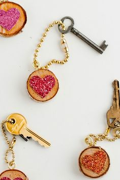 These glittered keychains make wonderful Valentine's Day gifts. All you need is a Martha Stewart Crafts Heart Punch, Glitter Paper, Decoupage, and an easy tutorial from Flax & Twine! #marthastewartcrafts #12monthsofmartha