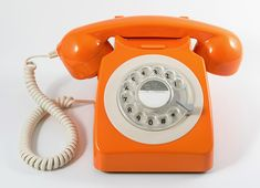 STUNNING ORANGE 1970's STYLE ROTARY DIAL TELEPHONE