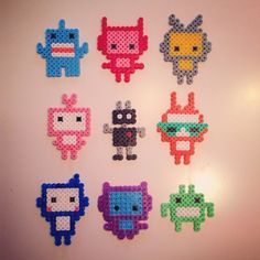 Made these really cute robots and monsters and turned them into a mobile for a babys crib. I used an empty mobile arm and nylon thread to hang them. 3d Perler Bead, Pearler Beads, Fuse Beads, Melty Bead Patterns, Hama Beads Patterns, Beading Patterns, Monster Party, Robot Monster, Hama Beads Design