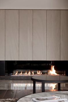 Like the cabinetry above this fireplace by DA Interior Taiwan Home Fireplace, Modern Fireplace, Living Room With Fireplace, Fireplace Design, Fireplaces, Living Tv, Home Living Room, Cladding Design, Contemporary Interior