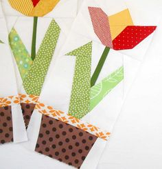 Block 97 - Tulip Trilogy.  The last of three tulips made from a wonderful paper-pieced FREE pattern by Regina Grewe.  All three will hang together on a little wall quilt in my hall.