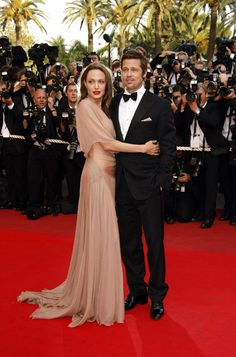 Cuddling, Brad and Angelina arrive at Cannes Film Festival in 2009