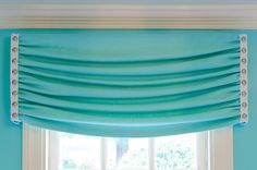 (Kitchen treatment)  *Not the color or the style - but the idea of a fixed cornice that loos like a roman shade - with a roller shade hidden behind it. Gray linen poss.