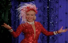 Marilyn Monroe signature red-sequined showgirl gown with feathered hat for Gentlemen Prefer Blondes