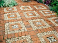 Bricks and pebbles arranged in an ordered layout add visual  interest in this example of a natural paving choice suited to a large landscaping design.