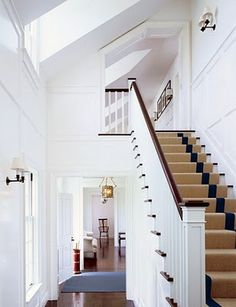 crisp white with a simple stripe stairway carpet.