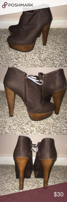 NWOT. Quipid Booties NWOT. Great Condition. Brown faux leather upper and wood like heel/bottom. 5 inch heel and 1.5 inch platform. Perfect for the upcoming fall season. Quipid Shoes Ankle Boots & Booties