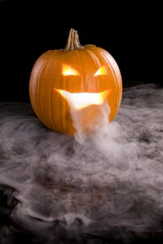 Five Halloween Science Ideas: black light magic, smoky fingers, ghost bubbles, crystal ball, and balloon banshee.