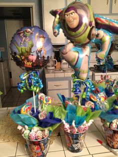 Buzz lightyear centerpieces for my nephew's birthday party toy story centerpieces, centerpieces for birthday party Fête Toy Story, Toy Story Baby, Toy Story Theme, 2 Birthday, Toy Story Birthday, 3rd Birthday Parties, Birthday Ideas, Toy Story Centerpieces, Birthday Party Centerpieces