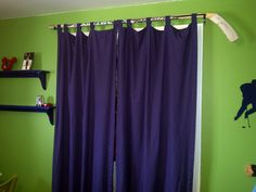 used a pinterest find to do the curtains - used a hockey stick to fit in with the hockey theme! Did one for the window, and one for the closet, since the kids seem to wreak doors.