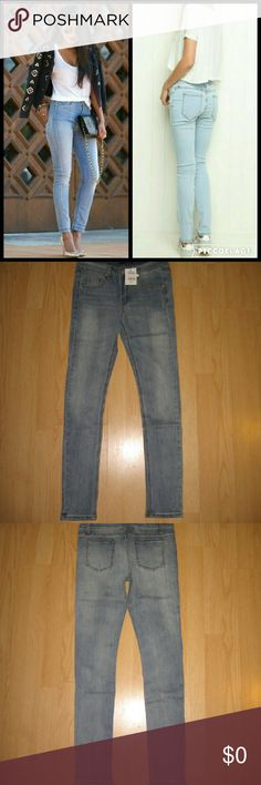 """Brandy Melville High Rise Skinny Jeans These jeans are brand new. They are a distressed high rise skinny jean in a light/medium blue wash. There is subtle distressing on the legs. The inseam is around 30"""" - 30.5"""" long. Small is around a size 24-25 and Medium is around a size 26-27. I'd be happy to give you exact measurements on each pair because there can always be differences in measurements between  psirs. Made of 98% cotton 2% elastane. Brandy Melville Jeans Skinny"""