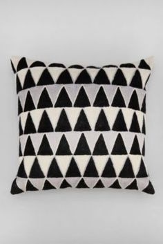 "Magical Thinking Embroidered Triangle Pillow.  Black and white. Urban Outfitters. To see more of the current geometric design trend, follow Jill Jordan's board ""Trending Triangle: Geometric Pattern Deigns"""