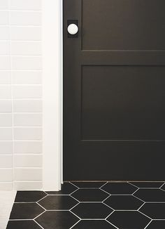 Studio Short Plate with a White Porcelain Knob in Oil-Rubbed Bronze