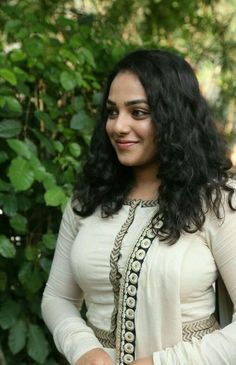 Nithya Menen is an Indian film actress and playback singer. She primarily works in South Indian films, where she has established herself as a leading actress. Beautiful Girl Indian, Most Beautiful Indian Actress, Beautiful Girl Image, Beautiful Actresses, South Actress, South Indian Actress, Beauty Full Girl, Beauty Women, Nithya Menen