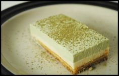 Layered Tea Mousse Cake composed of: 1. pistachio cake on the base; 2. tea mousse; 3. green tea mousse.
