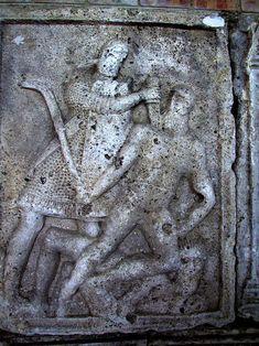 Adamclisi Metope. Legionary stabbing downward into Dacian warrior's sholder.