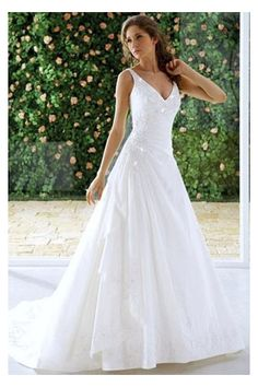 Alluring, amazing. Artistic A-line wedding dress appreciates an enticing plunging neckline with flattering bodice dotted with beaded motifs and appliques. Pleated naturally waist reveals the chic skirt with caught-up style cascading down to the floor with a court train. Self-covered button closure finishes this style.