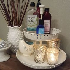 I love simple but pretty storage.  Keep your bath time essentials at hand so those long bubbles baths can be relaxing.  A few candles always helps calm the space as well.  The stand is from Ikea the milk glass pieces are from my grandmother and a garage sale.  The beautiful antiqued glass votives were on clearance at @magnolia and my little creamer that I use to rinse out the tub is another garage sale find. #displayablestorage #magnoliamarket #ikea #decoratingonabudget #spa by…