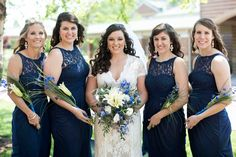 Bridal Party in Knoxville, TN with a lace wedding gown and navy bridesmaid dresses.