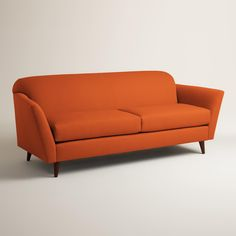 Marked by a mix of curves and clean lines, our sofa is custom made in the U.S.A. with soft woven upholstery. Its gently rolled back and dramatically angled arms and legs offer a fresh, affordable take on mid-century style.