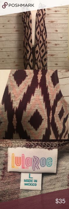 Lularoe joy vest Size large joy vest from Lularoe. Maroon, pink and gray Aztec print. LuLaRoe Tops