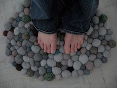 Love this idea....felted fiber balls turned into a rug!!!