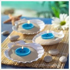 Beach theme wedding decorations - shells, sand, candles. DIY easy wedding decor.